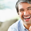 Closeup of a handsome mature laughing with copyspace - Стоковая фотография