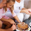 Royalty-Free Stock Photo: Birthday - Young girl cutting cake with parents