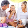 Royalty-Free Stock Photo: Happy Family enjoying their sweet daughter birthday