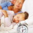 Young family sleeping together on the bed - Stock Photo