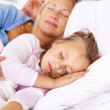 Sweet family sleeping together in a bedroom - Stock Photo