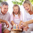 Royalty-Free Stock Photo: Young parents celebrating their daughter birthday at home