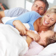 Royalty-Free Stock Photo: Happy family in playful mood on bed