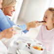 Royalty-Free Stock Photo: Sweet family having breakfast together