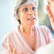 Elderly female in an argument with a man - Stock Photo