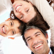 Royalty-Free Stock Photo: Portrait of happy parents with son huddling up against white