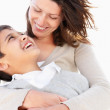 A loving moment between mother and son at play - Stock Photo