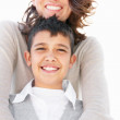 Royalty-Free Stock Photo: Portrait of a loving mature mother standing behind her happy son
