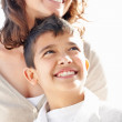 Royalty-Free Stock Photo: Close-up of mother and son looking away at something interesting