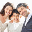 Mature father and mother with their happy little son - Stock Photo
