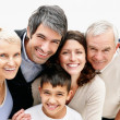 Portrait of a cheerful loving couple with parents and son - Stock Photo