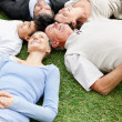 Royalty-Free Stock Photo: Happy relaxed multi generational family lying on grass in park
