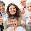 Portrait of a happy multi generational family wishing you luck - Stock Photo
