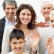 Royalty-Free Stock Photo: Multi generational family waving hands towards you in joy