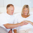 Royalty-Free Stock Photo: Handsome mature man touching his pregnant wife belly