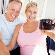 Royalty-Free Stock Photo: Happy couple - Taking a self portrait with camera