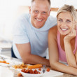 Royalty-Free Stock Photo: Happy mature couple smiling together in the kitchen