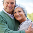 Royalty-Free Stock Photo: Happy senior couple hugging - Outdoor