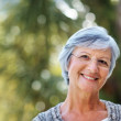 Royalty-Free Stock Photo: An attractive elderly woman smiling in the park