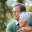 Old couple standing together looking away - Outdoor - Stock Photo
