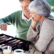 Royalty-Free Stock Photo: Old couple busy playing a game of backgammon