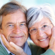 Royalty-Free Stock Photo: Portrait of happy old couple smiling together