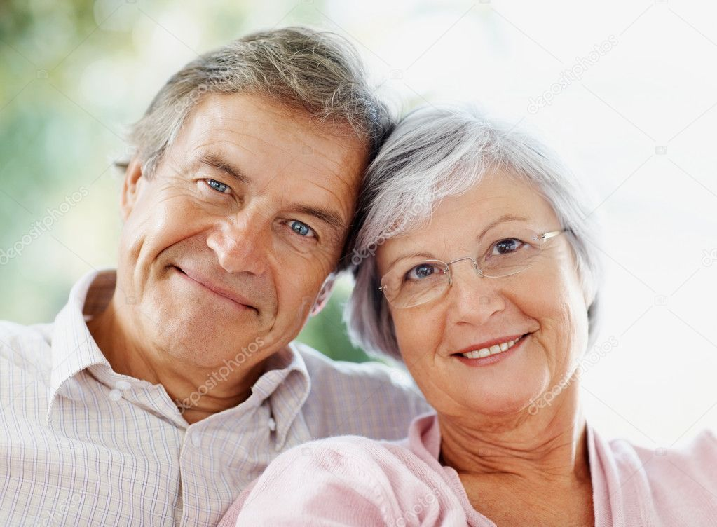 Closeup portrait of a smiling cute senior couple sitting together — Stock Photo #3360841
