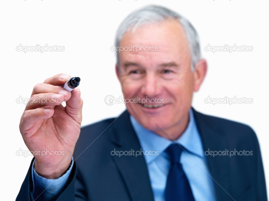 A confident business man writing something with a marker pen — Stock Photo #3361059
