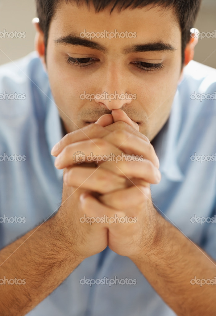 Closeup portrait of a young man praying to god with hope — Stock Photo #3361460