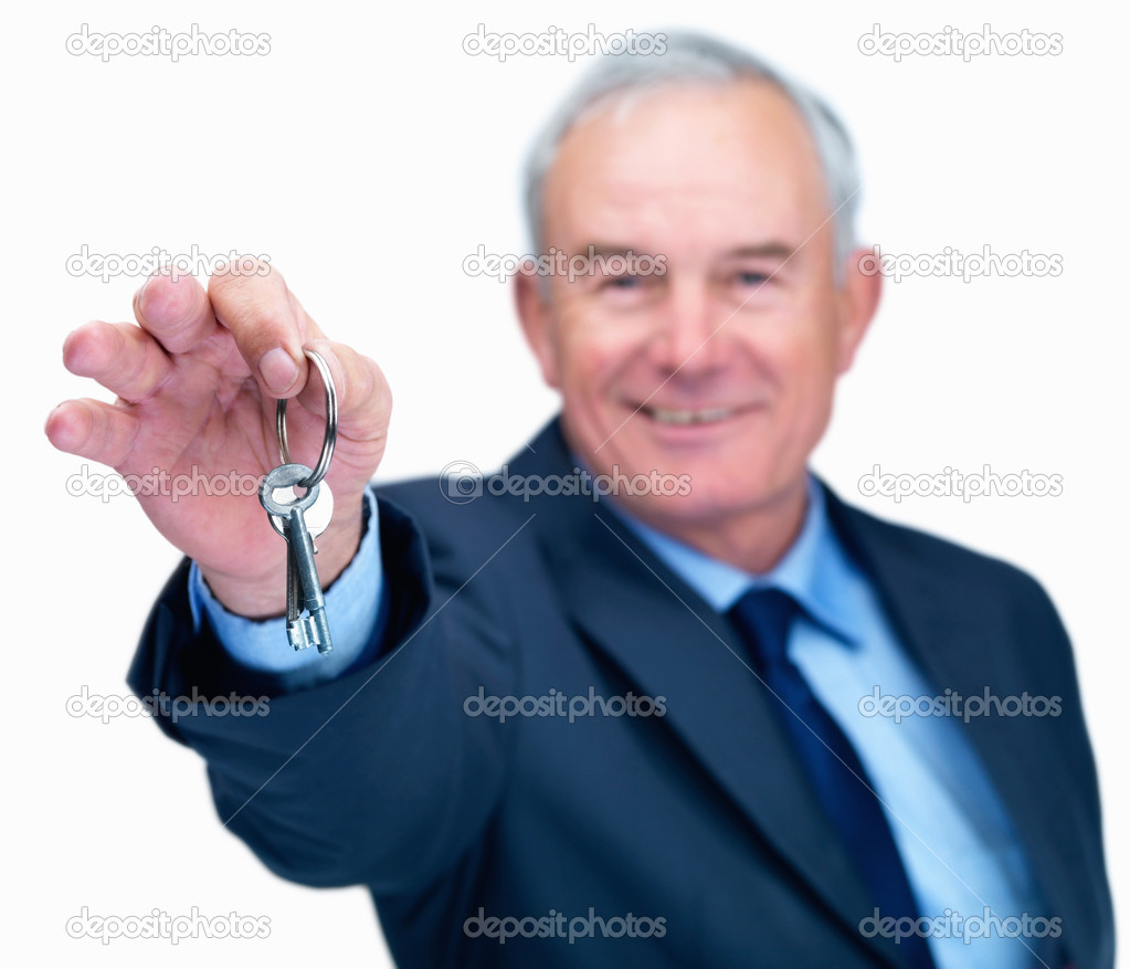 Senior business man handing you a key isolated on white background — Stock Photo #3361815