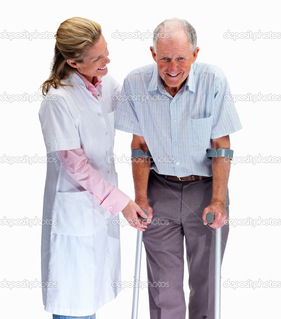 Portrait of a pretty nurse helping a senior man on crutches against white — Stock Photo #3363499