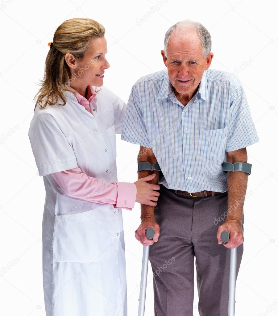 Portrait of a beautiful nurse helping a senior man on crutches against white — Stock Photo #3363502
