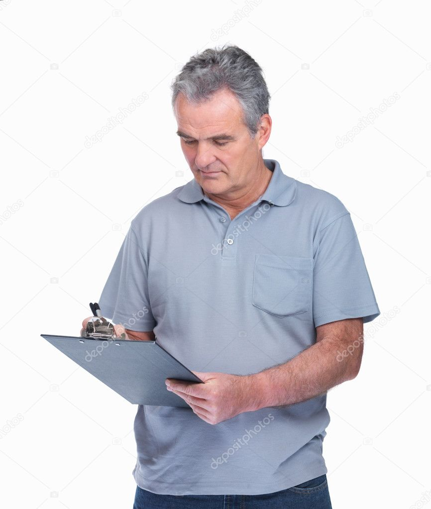 Portrait of a senior man with a notepad on while making notes — Stock Photo #3363998