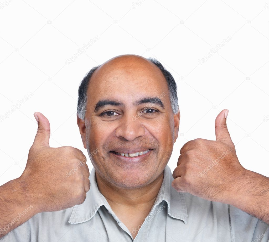 Closeup portrait of a happy mature man gesturing a success sign isolated on white — Stock Photo #3364189