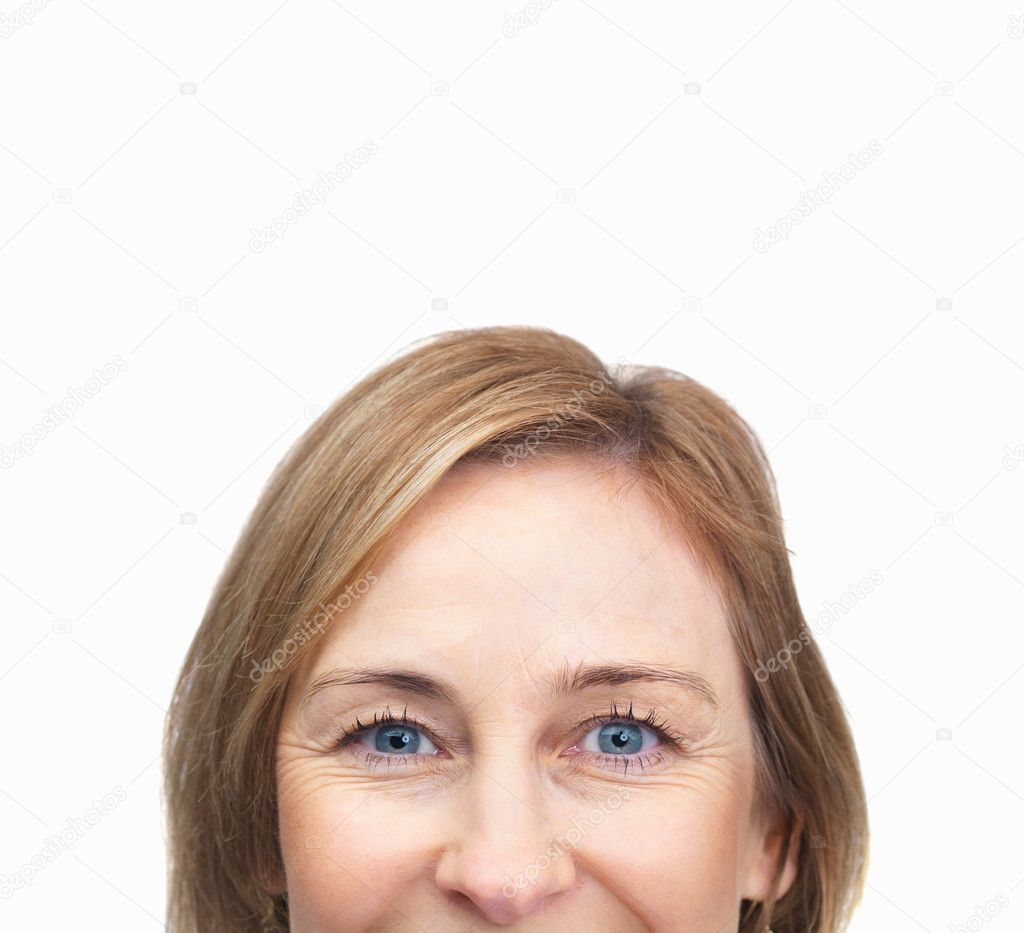 cropped image of mature female face over white background   copyspace