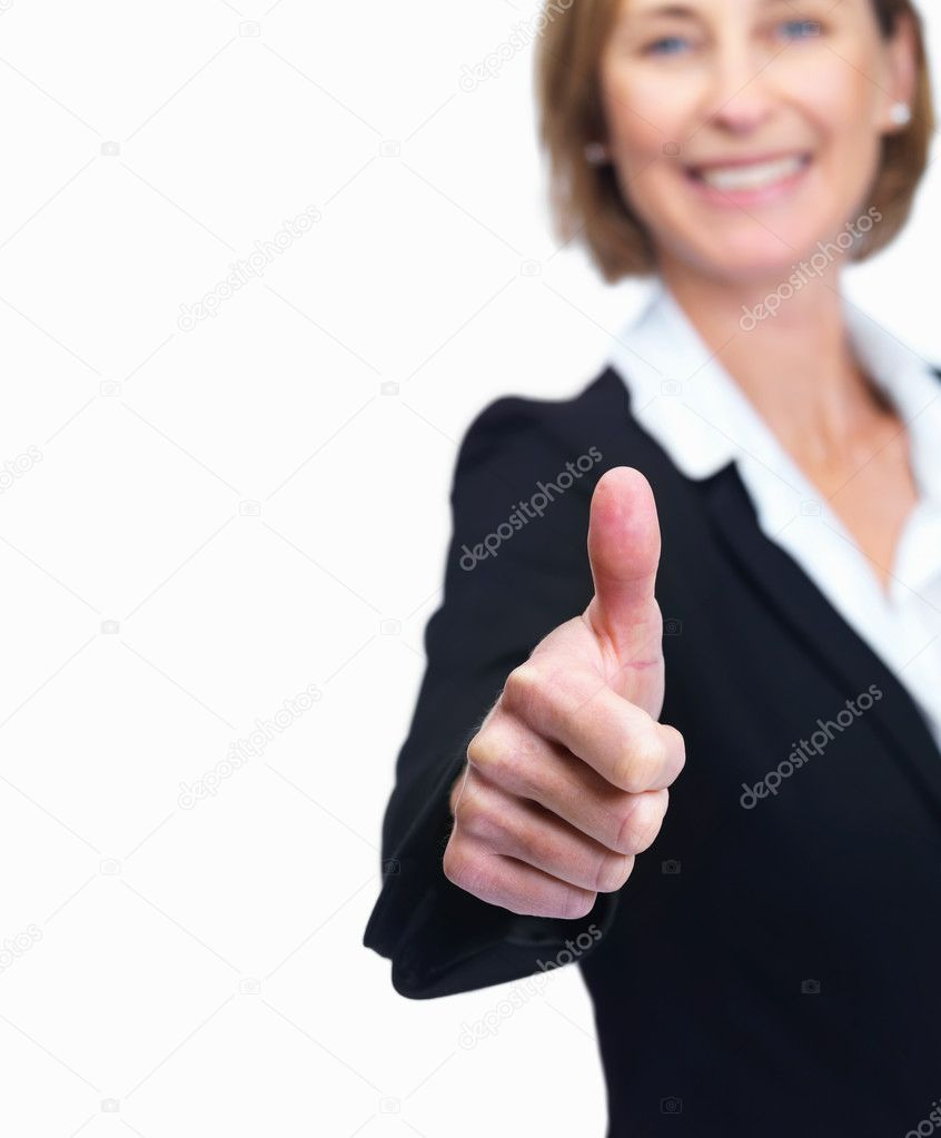 Cut image of a mature business woman showing thumbs up sign by copyspace over white background — Stock Photo #3364971
