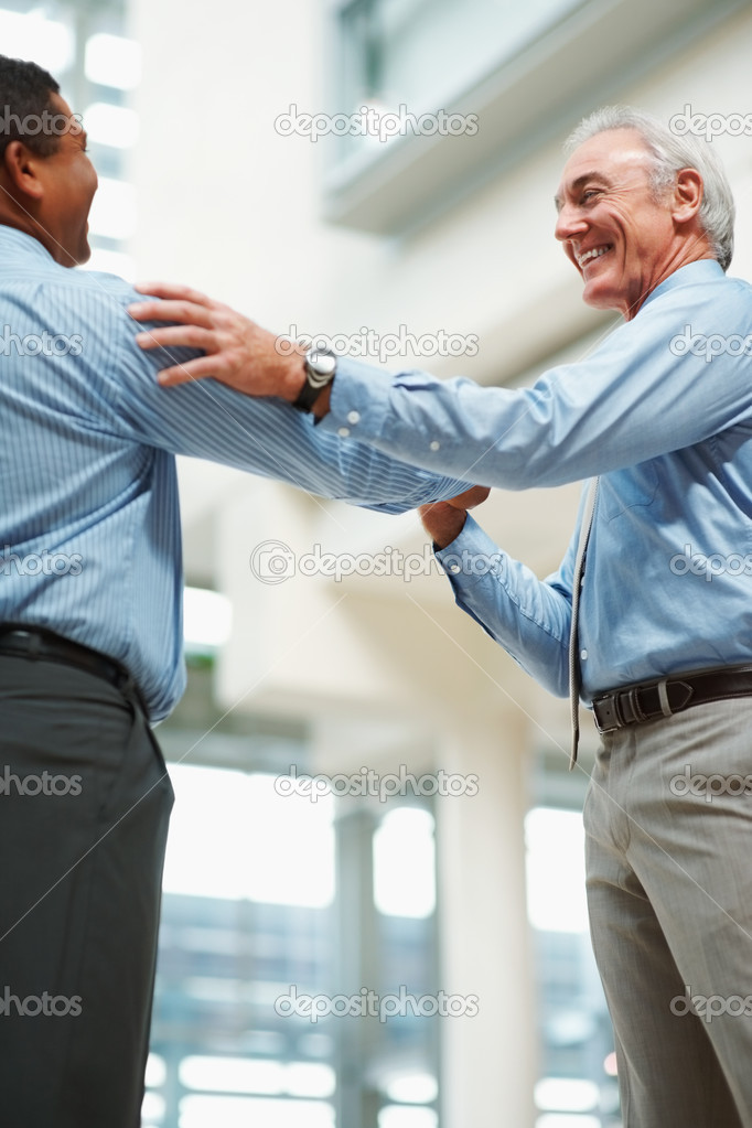 Good work - Senior business man congratulating his colleague  Stock Photo #3365484