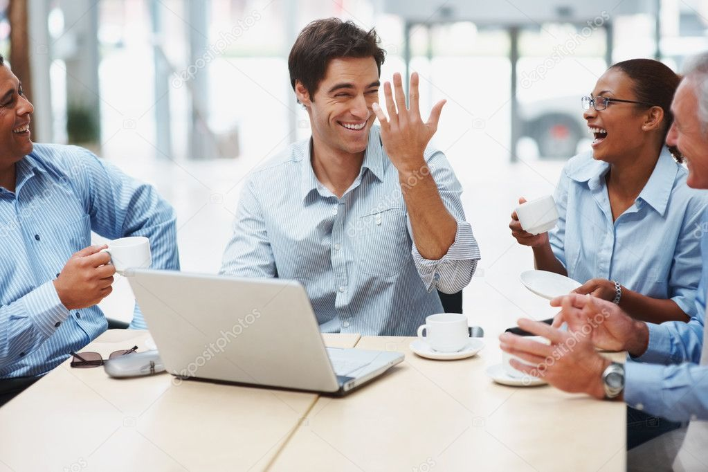 Multi ethnic business executives sitting together and having a joyful time at office — Foto Stock #3365559