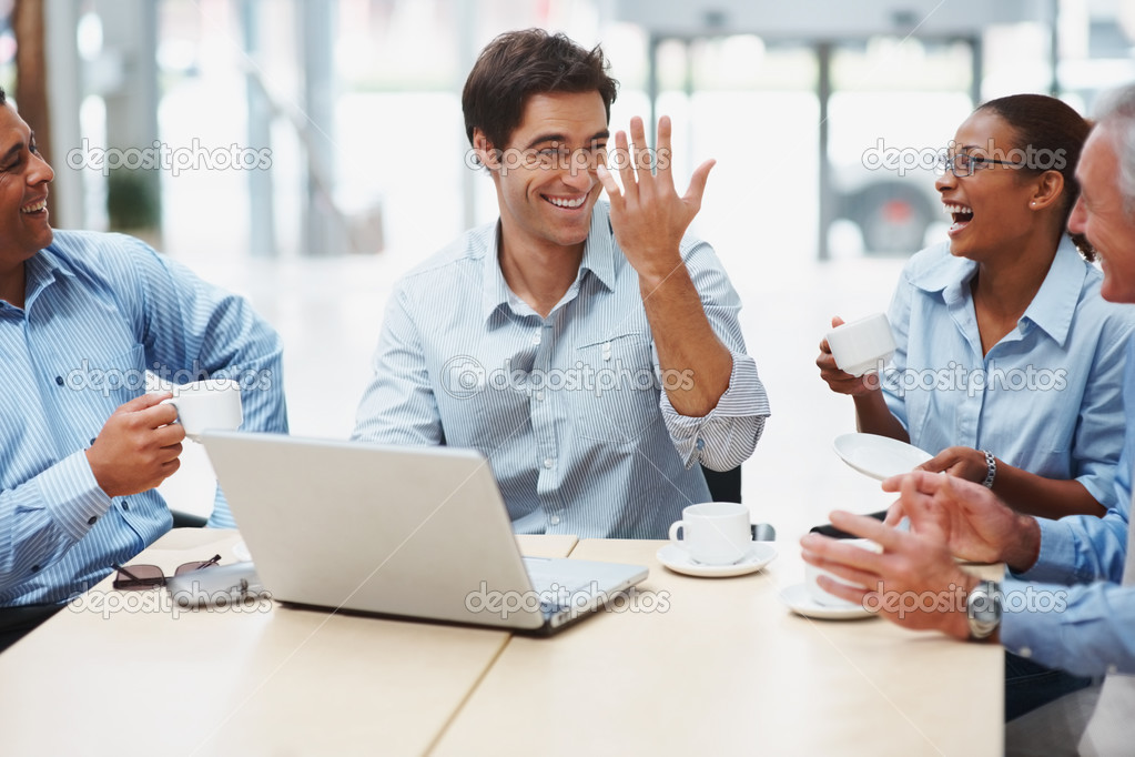Multi ethnic business executives sitting together and having a joyful time at office — Stockfoto #3365559