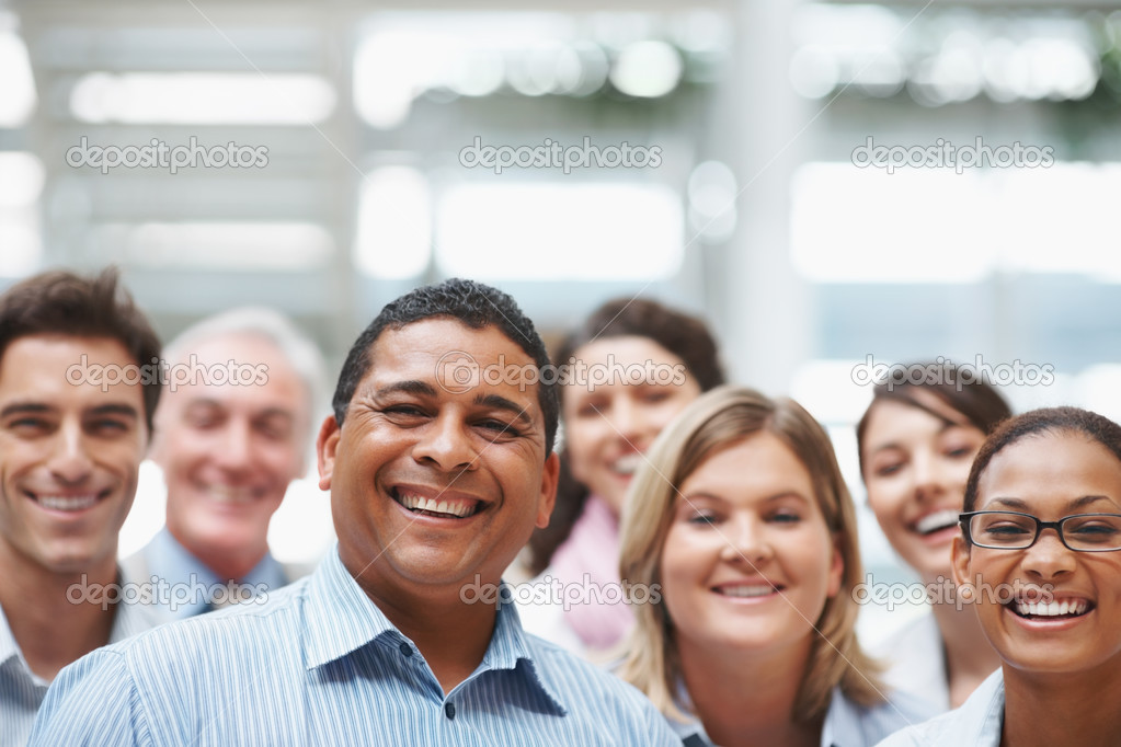 Business portrait - Happy multi ethnic executives standing together with copyspace — Stock Photo #3365565