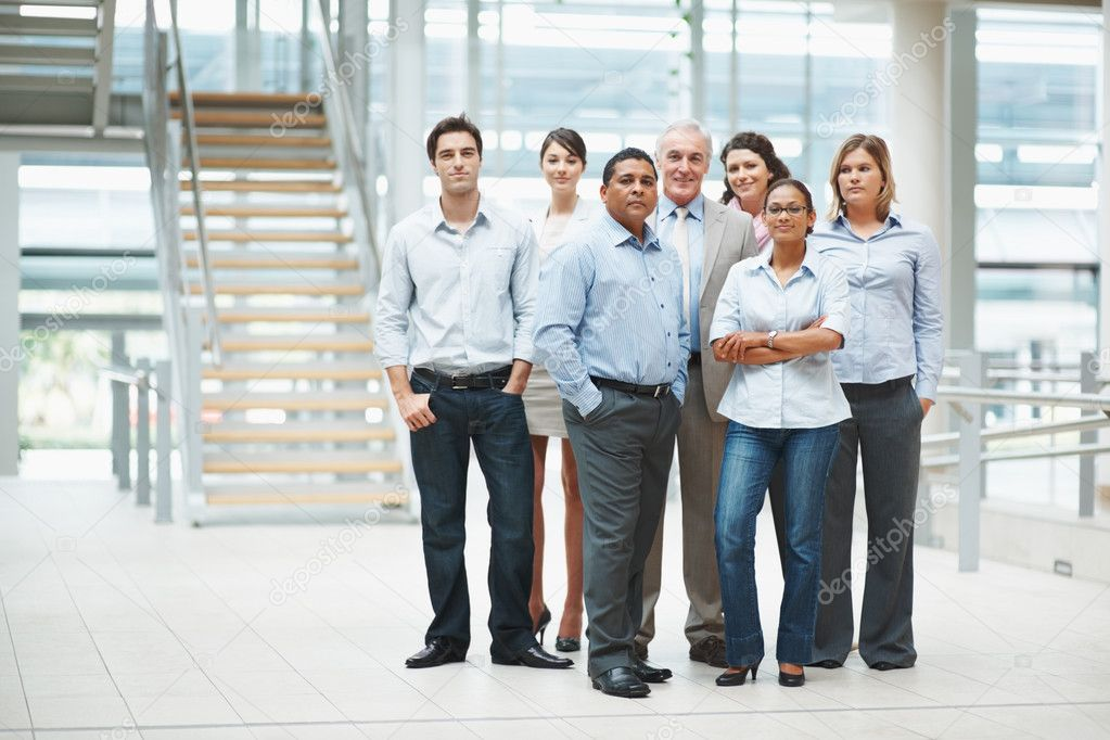 Portrait of confident business standing together in a group at office — Stock Photo #3365594