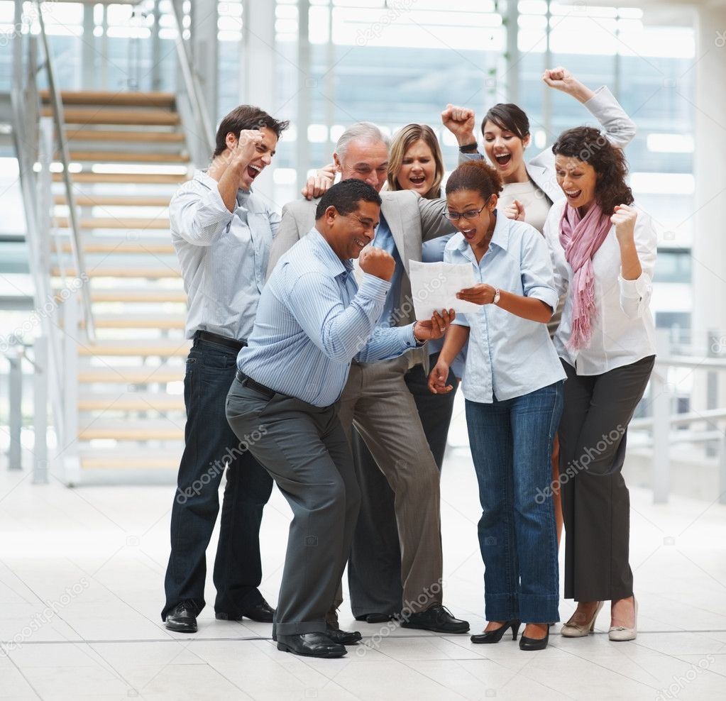 Happy group of business excited about the approval of a contract — Stock Photo #3365621