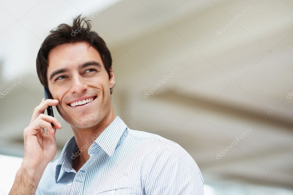 Happy young man speaking on cellphone and looking at copyspace — Stok fotoğraf #3365786