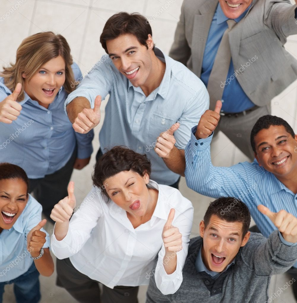Top view of a happy team of business colleagues gesturing a thumbs up sign — Stock Photo #3365892