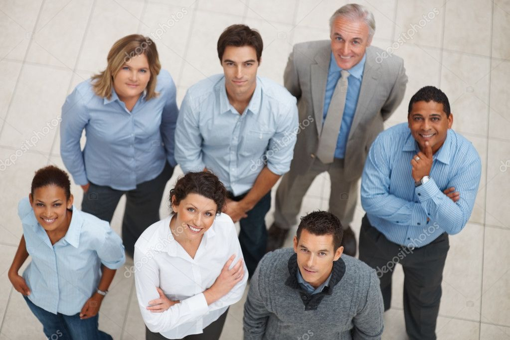 Top view of a smiling group of business standing together and looking up — Stock Photo #3365894