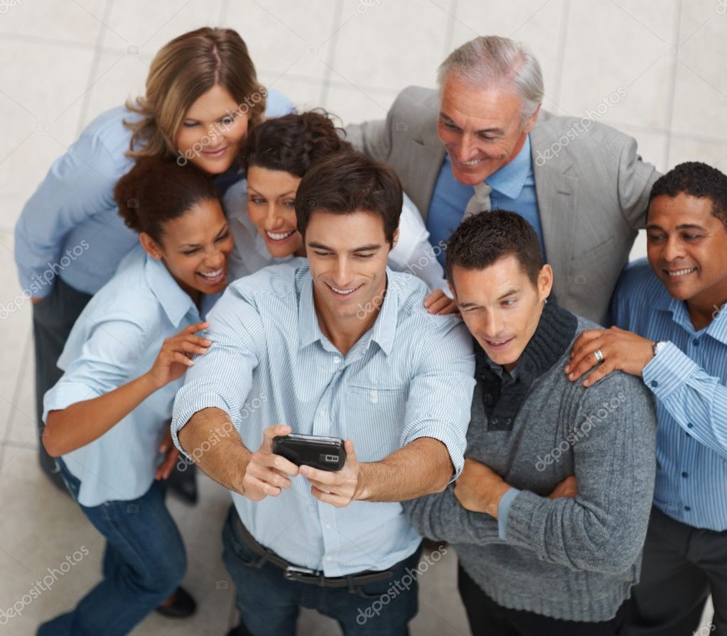 Top view of multi ethnic business posing for a self team photograph — Stock Photo #3365899