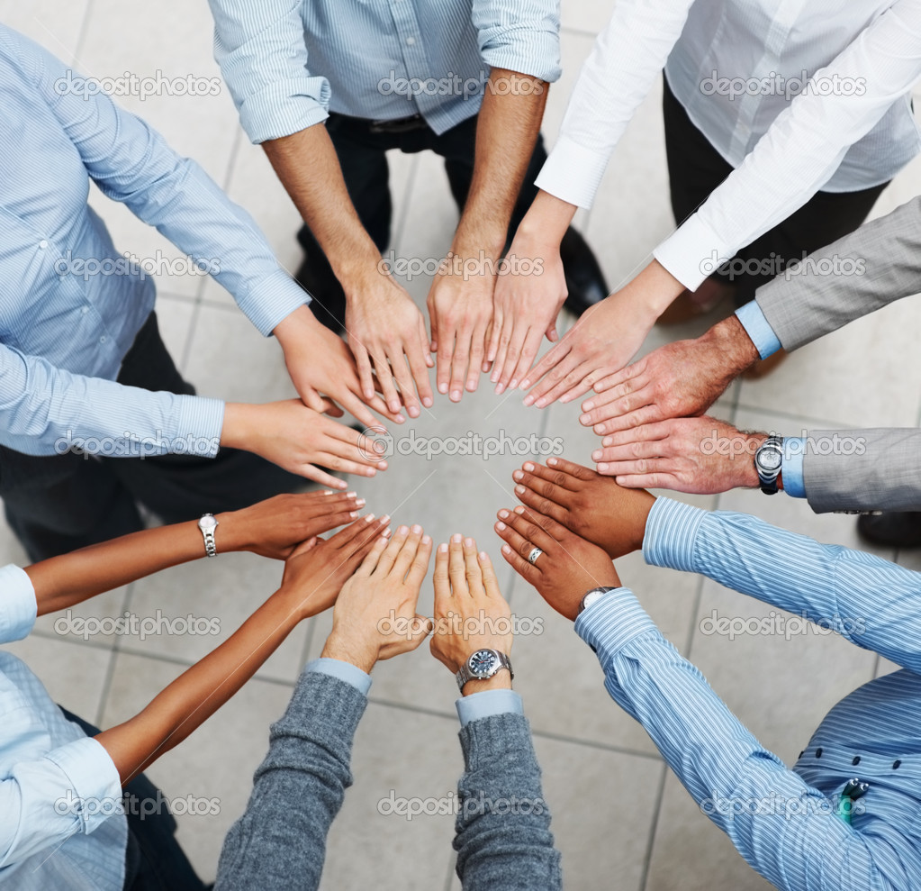 Top view of a group of business taking an oath in a circle — Stock Photo #3365918