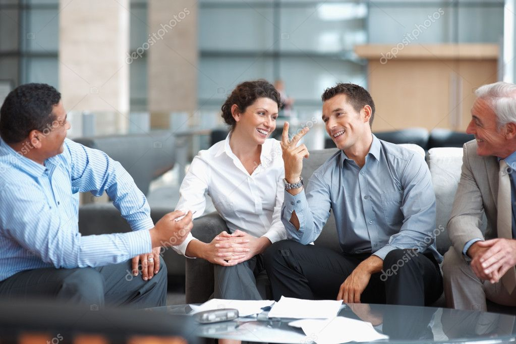 Group of successful multi ethnic business team having a casual talk  Stock Photo #3366020