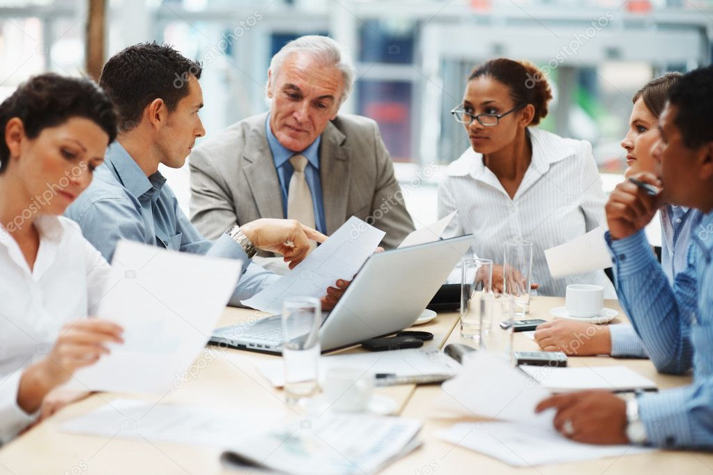 Multi ethnic business executives at a meeting discussing a work — Lizenzfreies Foto #3366141