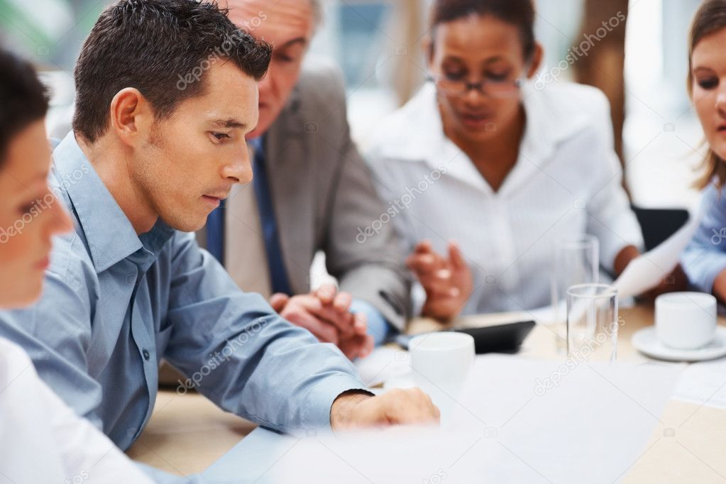 Team of multi ethnic business discussing work — Stock Photo #3366145